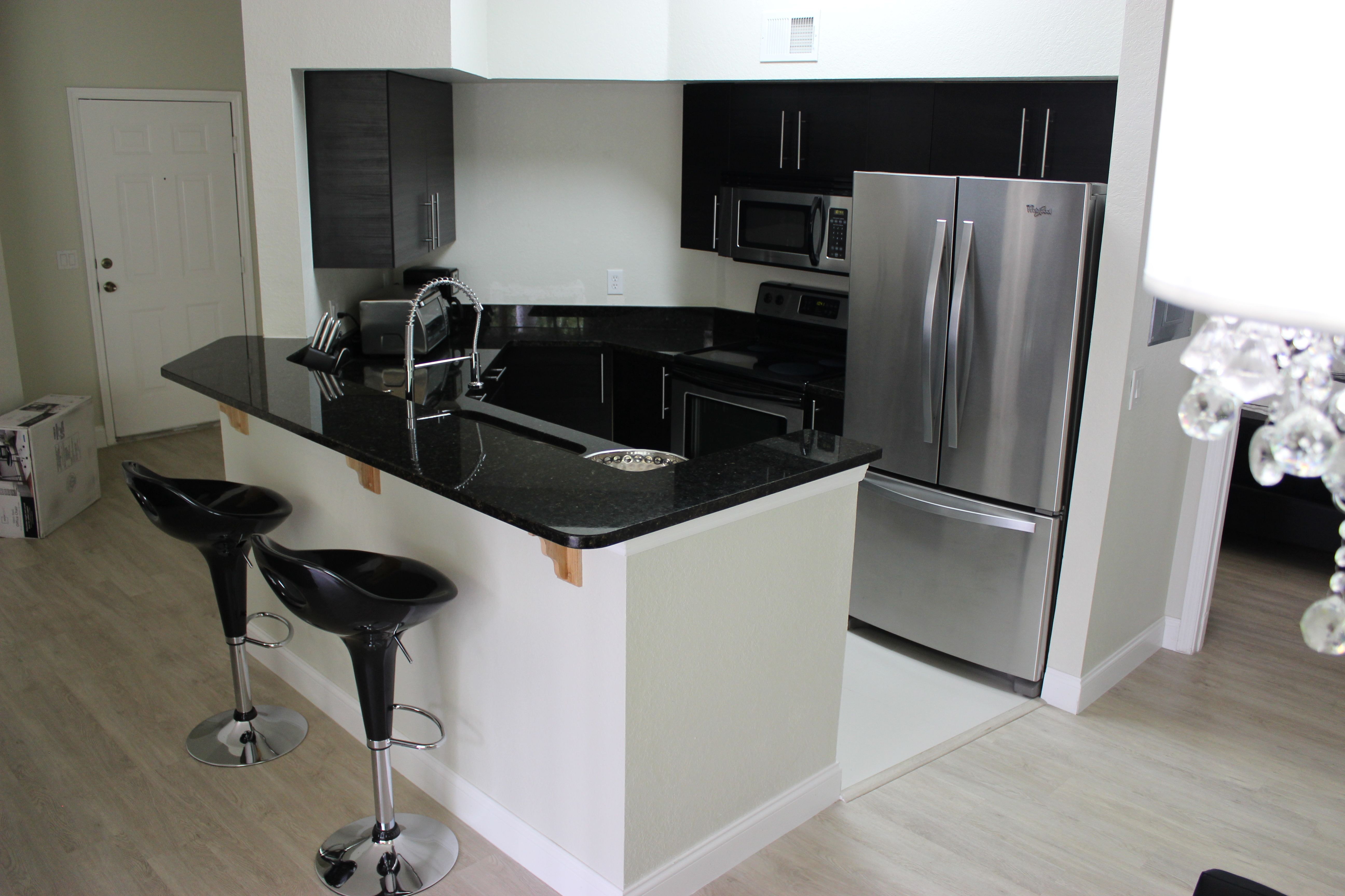 Kitchens With All Utilities Included In Orlando Corporate Housing Furnished Apartment Furnishings