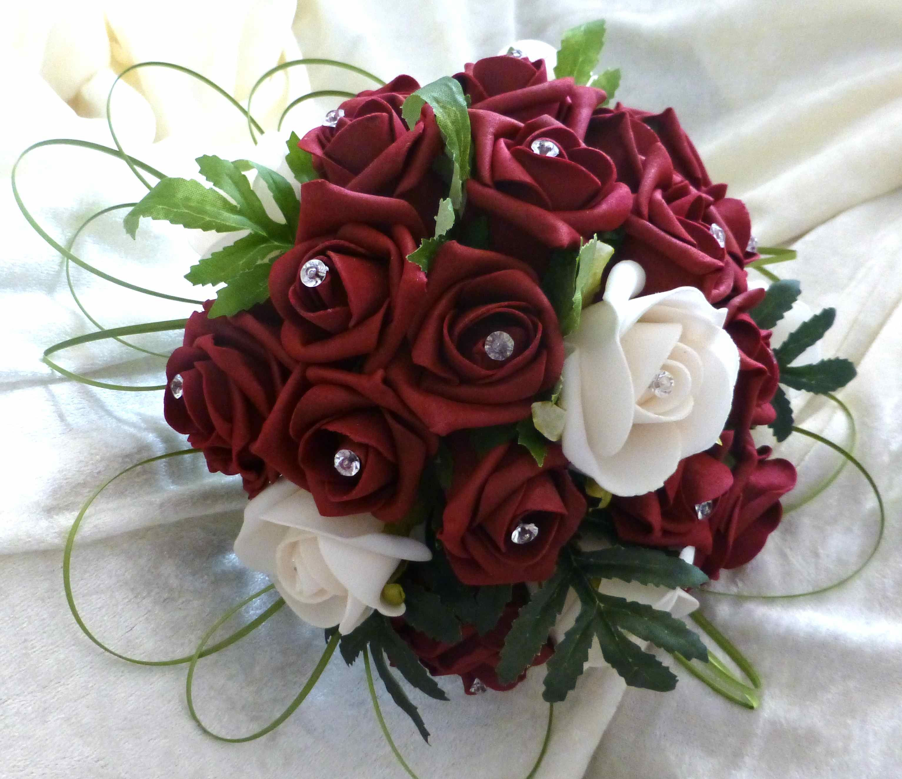 Artistic Design Using Onion Grass Foam Roses And Diamantes