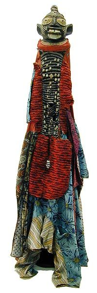 Yoruba Egungun Costume, Nigeria. The word Egungun refers to masking associated with honored male lineage ancestors. Egungun masquerades are performed throughout Yorubaland but the costune styles are extremely diverse as a result of both regional preferences and the fertile imagination of artists and patrons. Many Egungun costumes consist entirely of costly and extravagantly embellished cloth while others include carved headdresses.