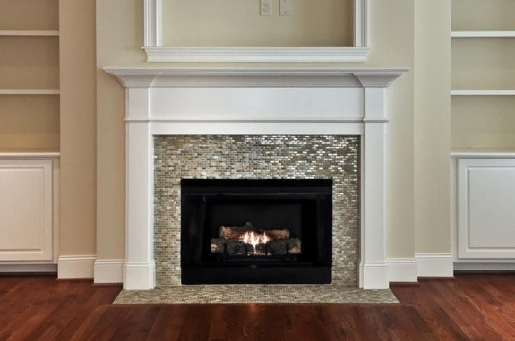 Fireplace with glass tile traditional white painted wood surround maybe use  touch of this in kitchen backsplash also