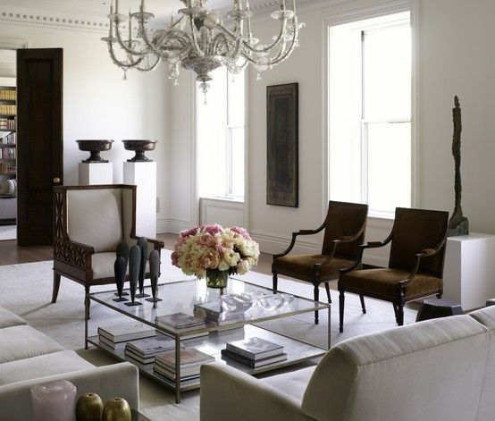 cream sofa with dark chairs and glass/crystal chandelier