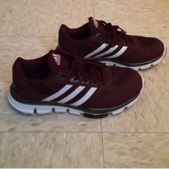 Maroon Adidas athletic shoes