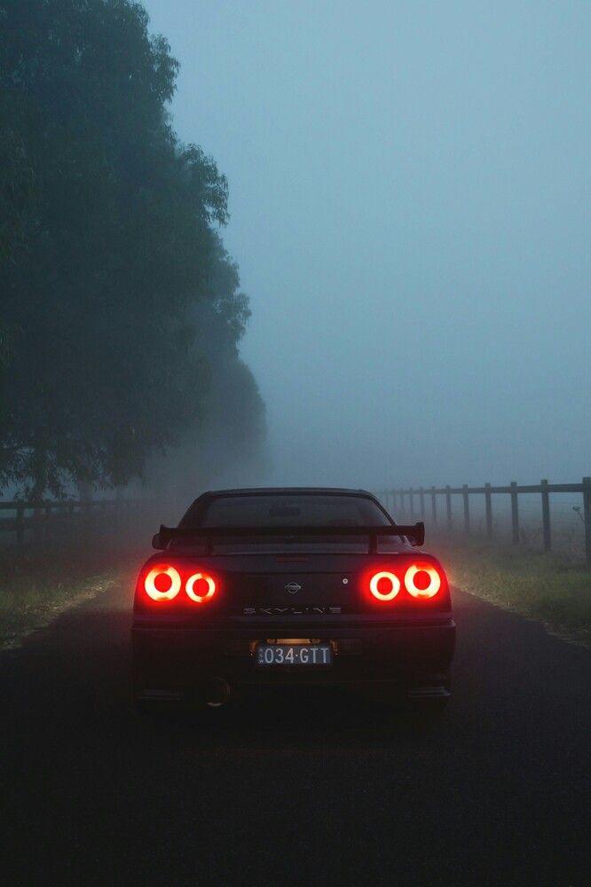 R34 Nissan Skyline tails in the fog.