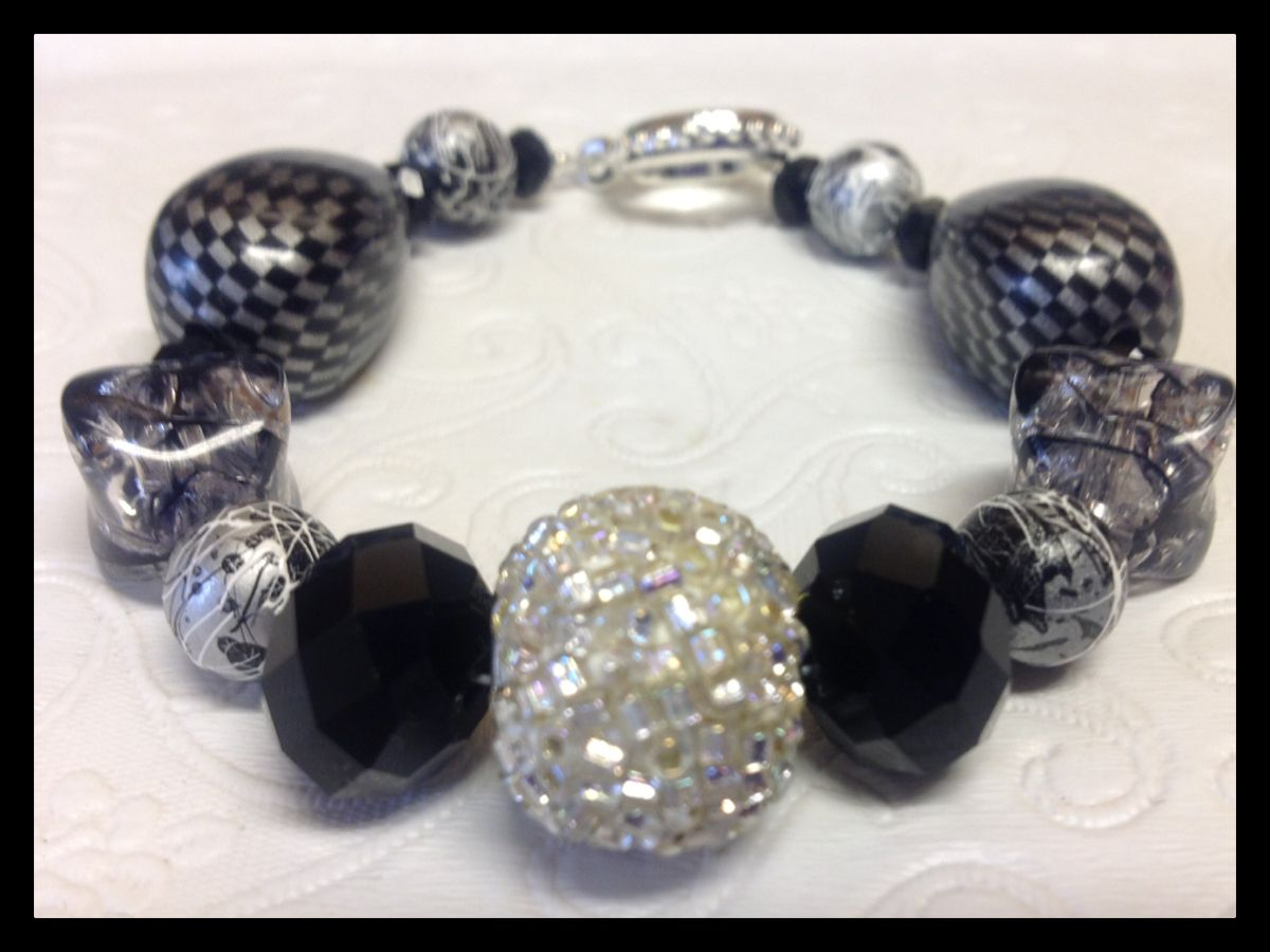 $15.00  Black & white with a touch of chevron and some sparkle.  Finished with a silver round toggle clasp.
