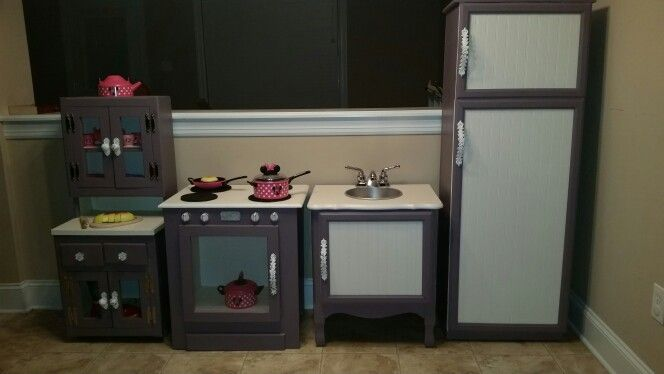 Play kitchen... hutch is handmade, but oven & sink are refurbished end tables, and the fridge is a repurposed bookcase