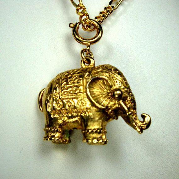 Trunk up elephant pendant necklace gold shiny metal amulet vintage trunk up elephant pendant necklace gold shiny metal amulet aloadofball Choice Image