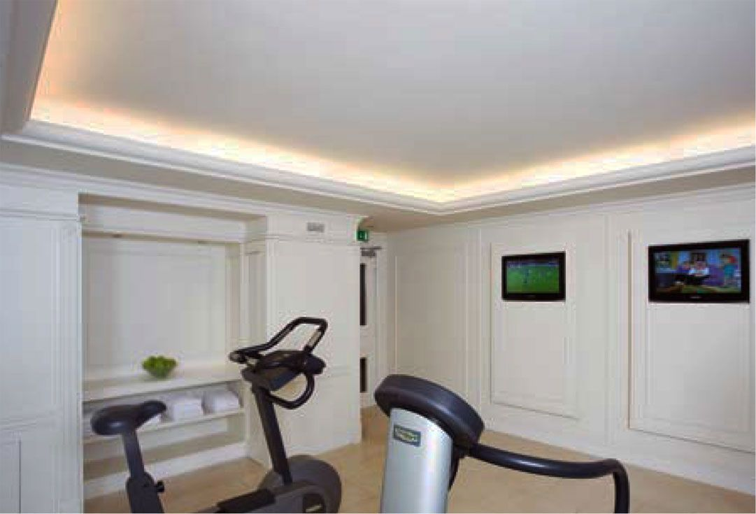 home gym with crown molding and indirect lighting; home gym design