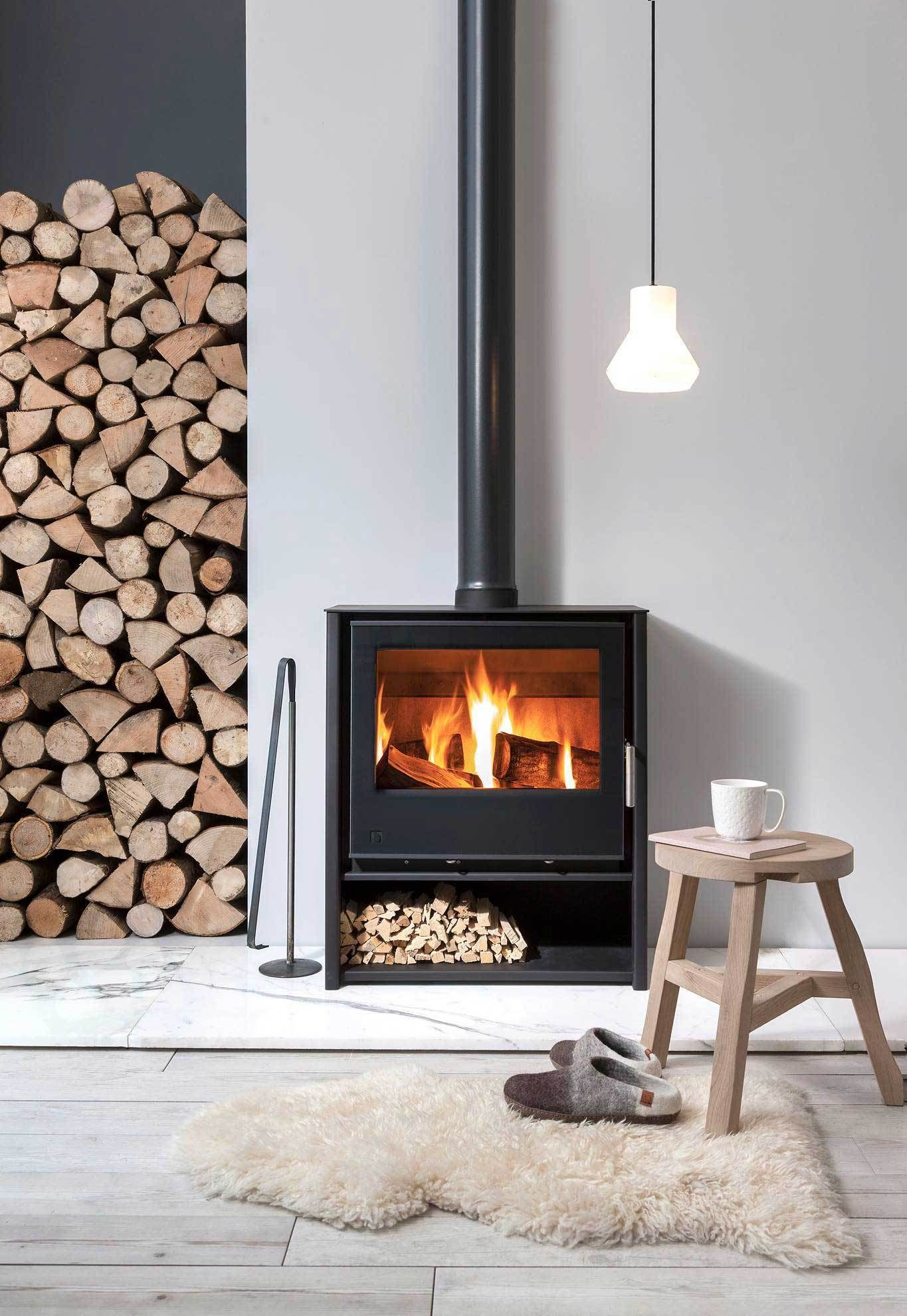 A Guide To Choosing And Installing A Wood Burning Stove These Four Wa Contemporary Wood Burning Stoves Freestanding Fireplace Wood Burning Stoves Living Room