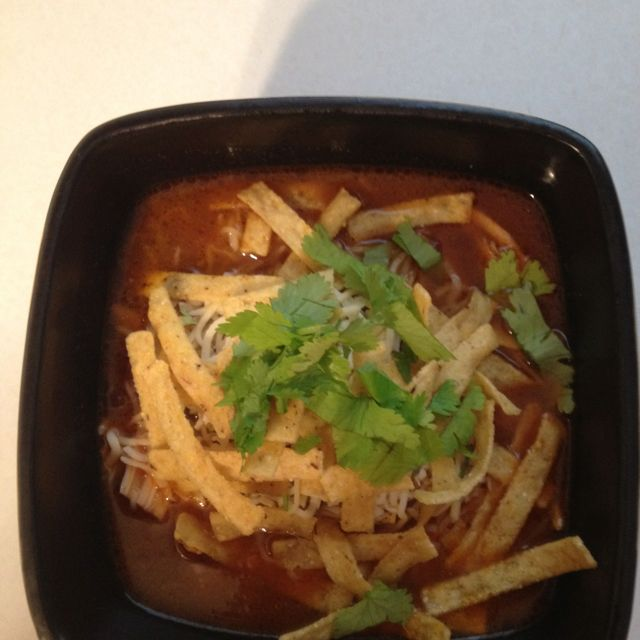 Chicken tortilla soup.  3 boneless skinless chicken breasts, seasoned with taco seasoning baked at 350 for 25 mins. Shred with fork, set aside. 2 T oil oil heat in a stock pot and cook until tender, Add 2T minced garlic, can of rotel w green chilies 2 cans black beans 1 can corn 6 C chicken stock 2 T tomato paste Add Chicken and a package of taco seasoning bring to a boil. Simmer 30-45 mins. Garnish with shredded monterey jack cheese, crispy tortilla strips and avocado. Enjoy!