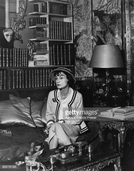 2d96be160a8 French fashion designer Coco Chanel (1883 - 1971) in her apartment at the  Hotel Ritz Paris