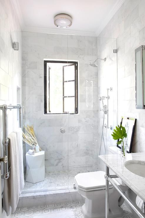Amazing bathroom features a seamless glass walk-in shower filled ...