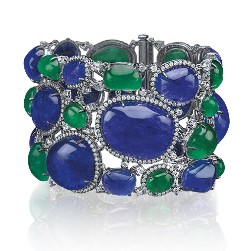 Cellini Jewelers Cabochon Gemstone Bracelet 3-row bracelet with cabochon tanzanites and emeralds edged with pave diamonds; set in 18-karat white gold.