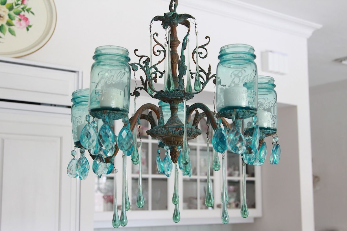 Instead of re-wiring an old chandelier, attach mason jars with ...