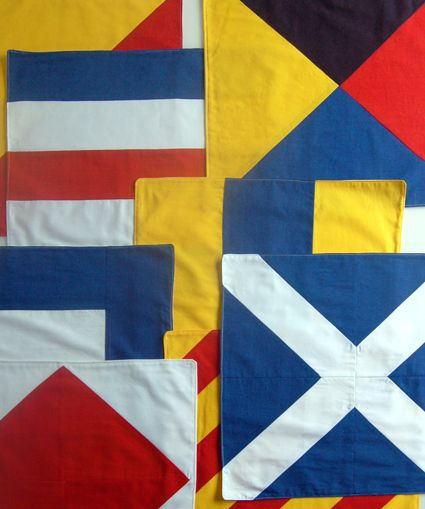 Free tutorial on DIY nautical flag napkins. I am in LOVE with this project! I've been wanting to get around to a nautical flag themed quilt for the kids ever since we moved to the water house. Thanks for doing the measuring and laying out the steps so nicely, Purl Bee!