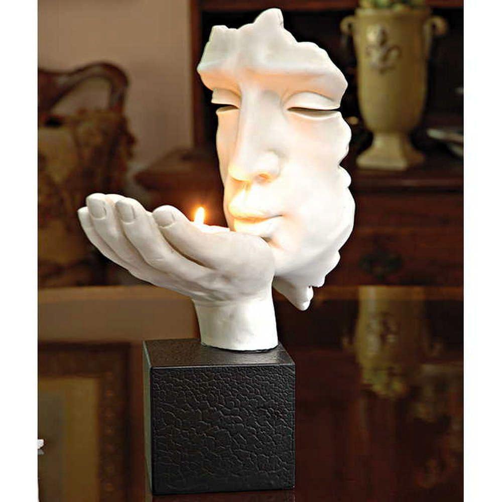 Blowing Kiss Sculpture