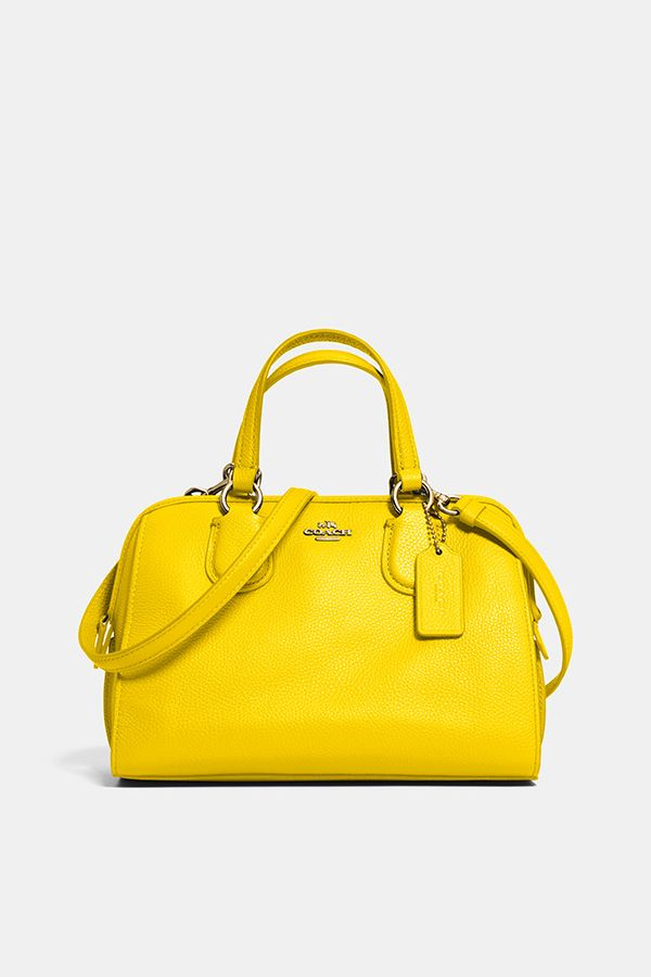 Light, bright leather with pretty ring hardware  the Coach Mini Nolita  Satchel in yellow. 9a292e54ab