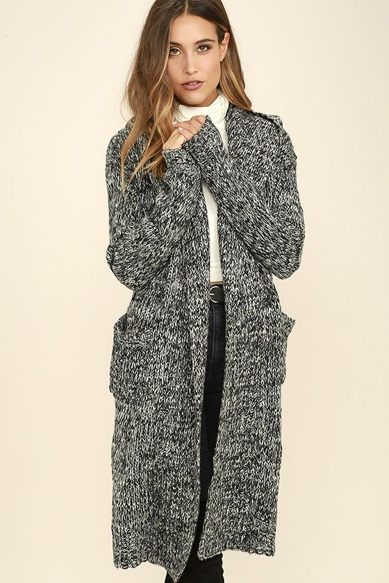 61ab77cb9b Black and White Long Cardigan Sweater. Thick marled knit forms long sleeves  and an extra long