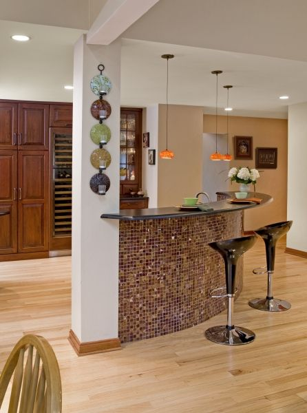 view of newly created bar area which features red onyx mosaic tiles on a curved bar front and decorative glass pendant lights above the counter