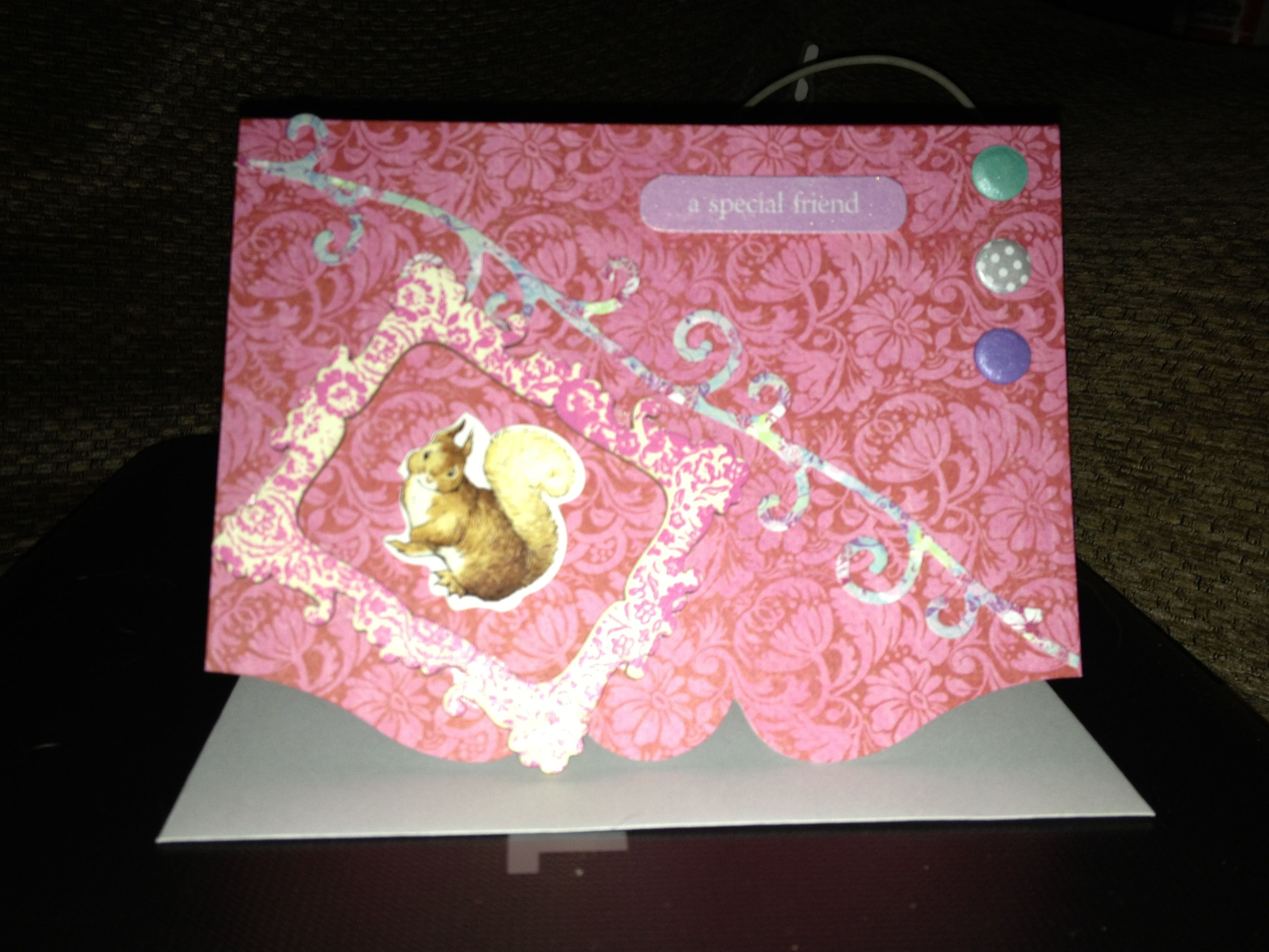 preprinted card with added embellishments with images