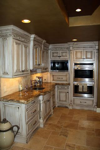 I love the double oven  style of cabinets in this french country