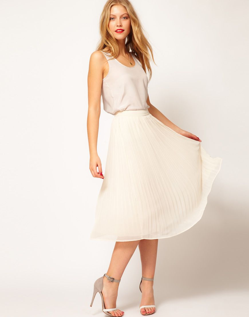 ASOS Skirt with Soft Pleats  $47.68  This pleated midi skirt by ASOS Collection has been crafted from lightweight chiffon fabric. The details include: a fitted high waist with a concealed side zip fastening and micro pleats through the skirt. The midi skirt has been cut with a midi length.