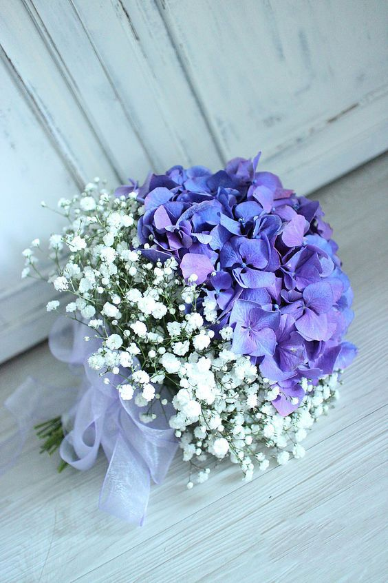 BRIDE'S BOUQUET IN THE WEDDING SYMBOLIZES HAPPINESS – Page 28 of 57