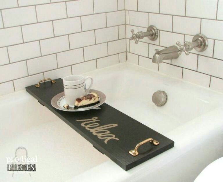 Need this in the bathroom...bath tub tray to hold all those ...
