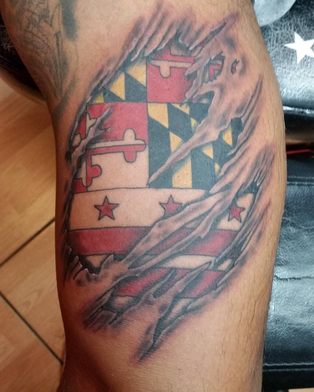 Maryland And Washington D C Flag Ripped Skin Tattoo