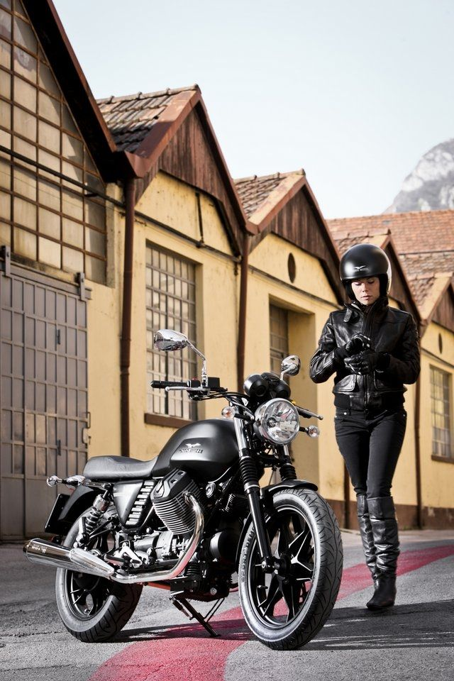 The Moto Guzzi V7 girl again  Man she goes well with that bike  Or