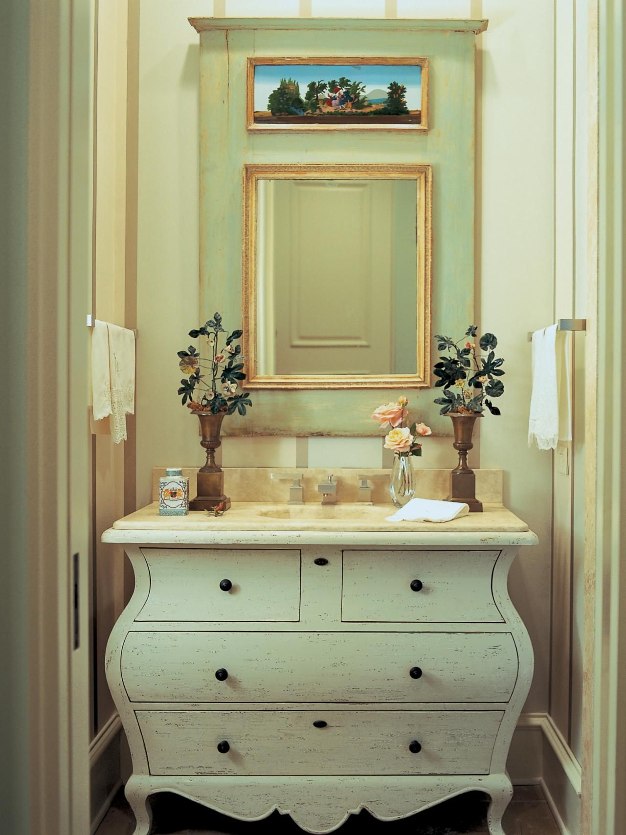 A Swedish Style Dresser Is Refurbished As A Vanity with A Sink In