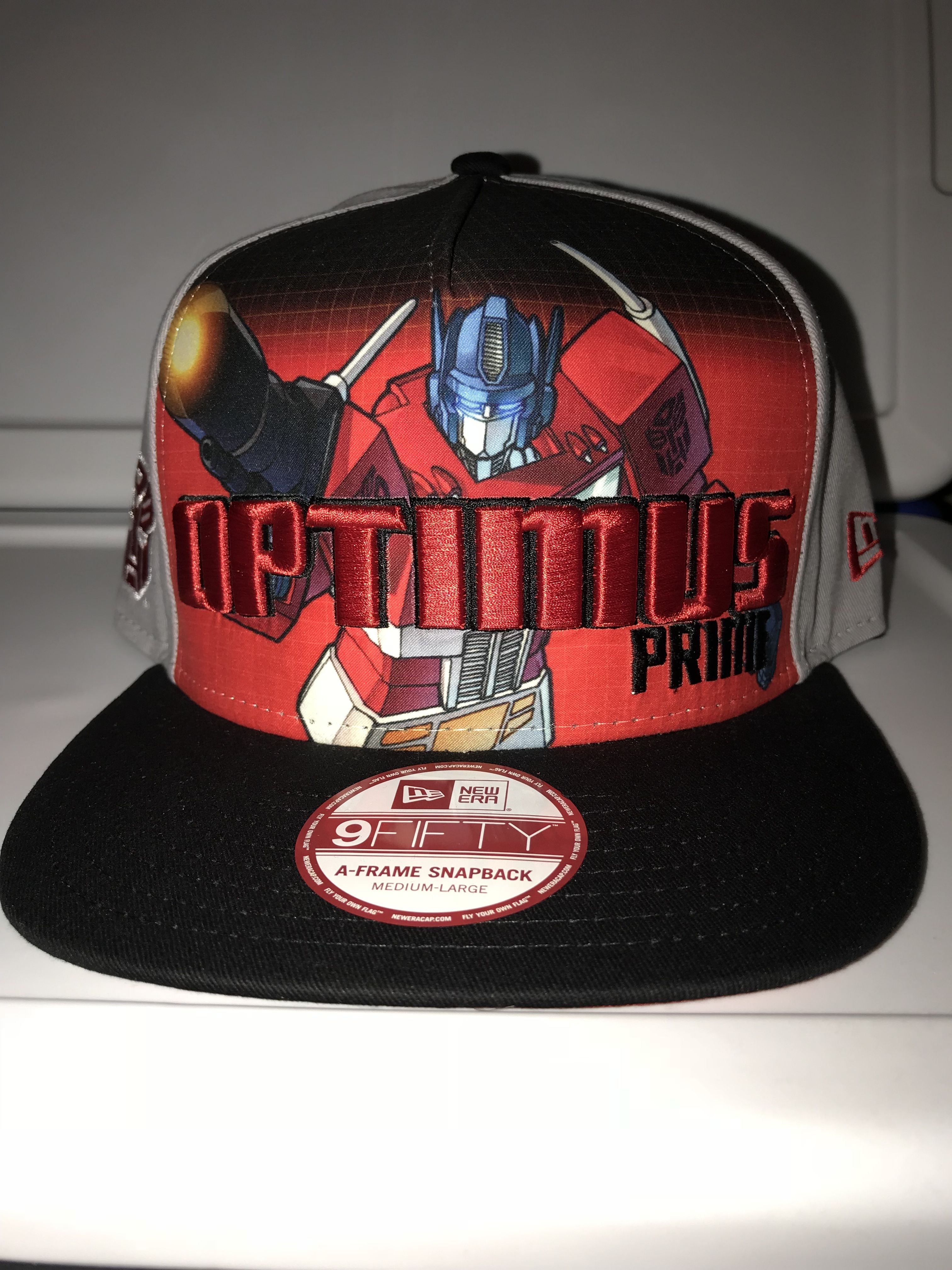 a688cac669c New Era Optimus Prime Transformers with autobot symbol on side   Optimus as  rig under brim 9FIFTY snapback