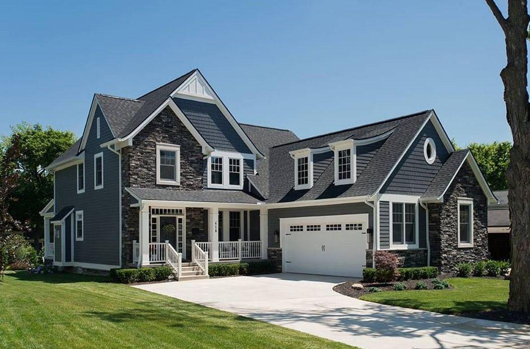 Blue home gray home home exterior stone white trim