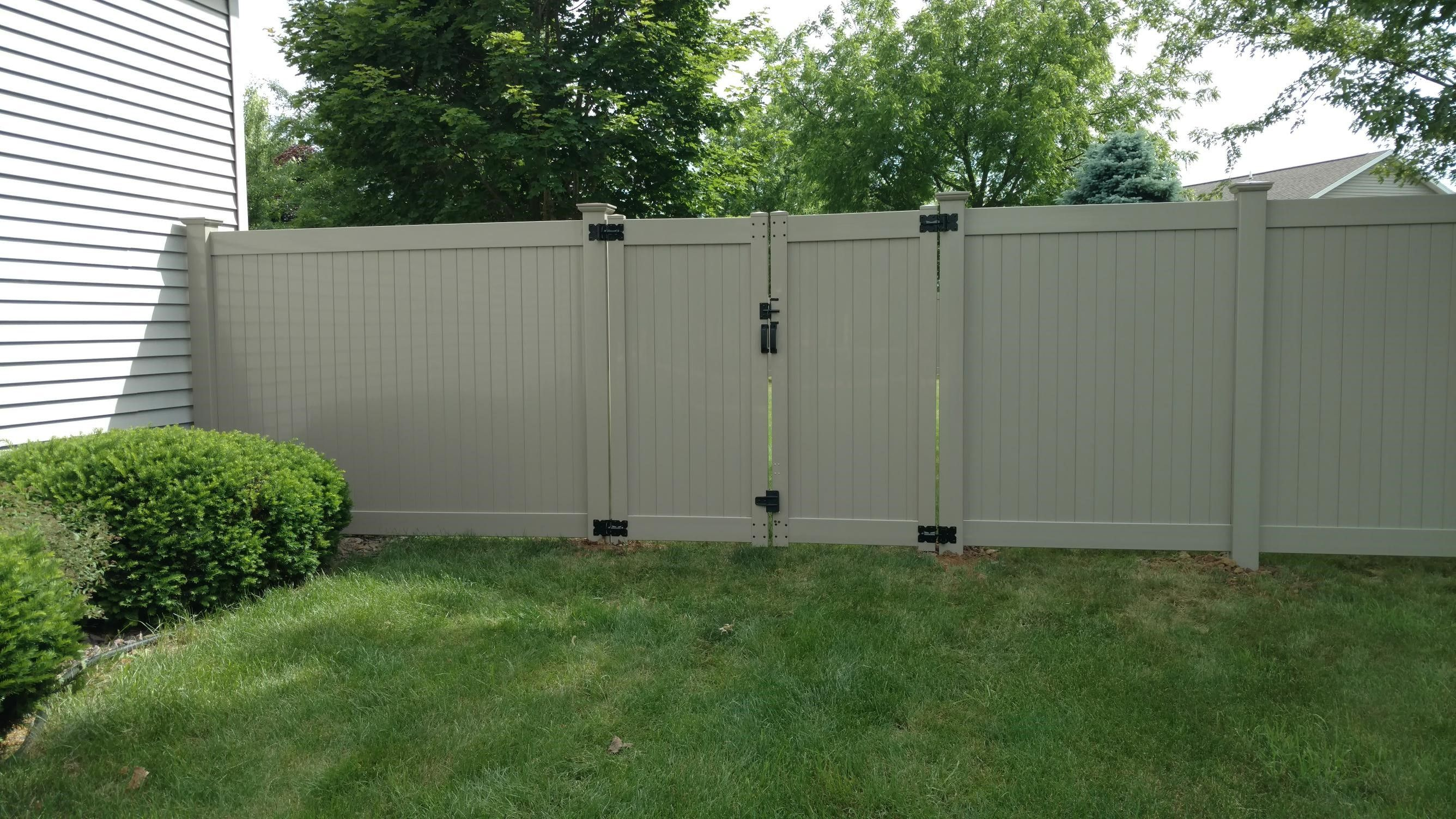 Polyvinyl Privacy Fence With Double Gate Vinyl Fence Building A Fence Security Fence