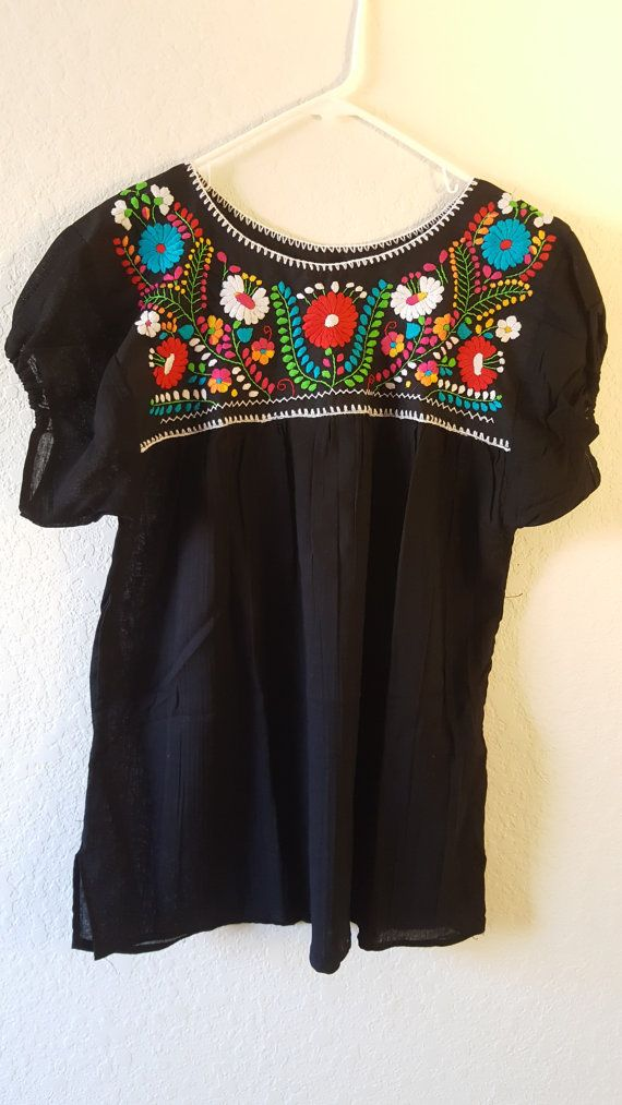 Mexican embroidered blouse with details just mastered by the community of  artists that we help to