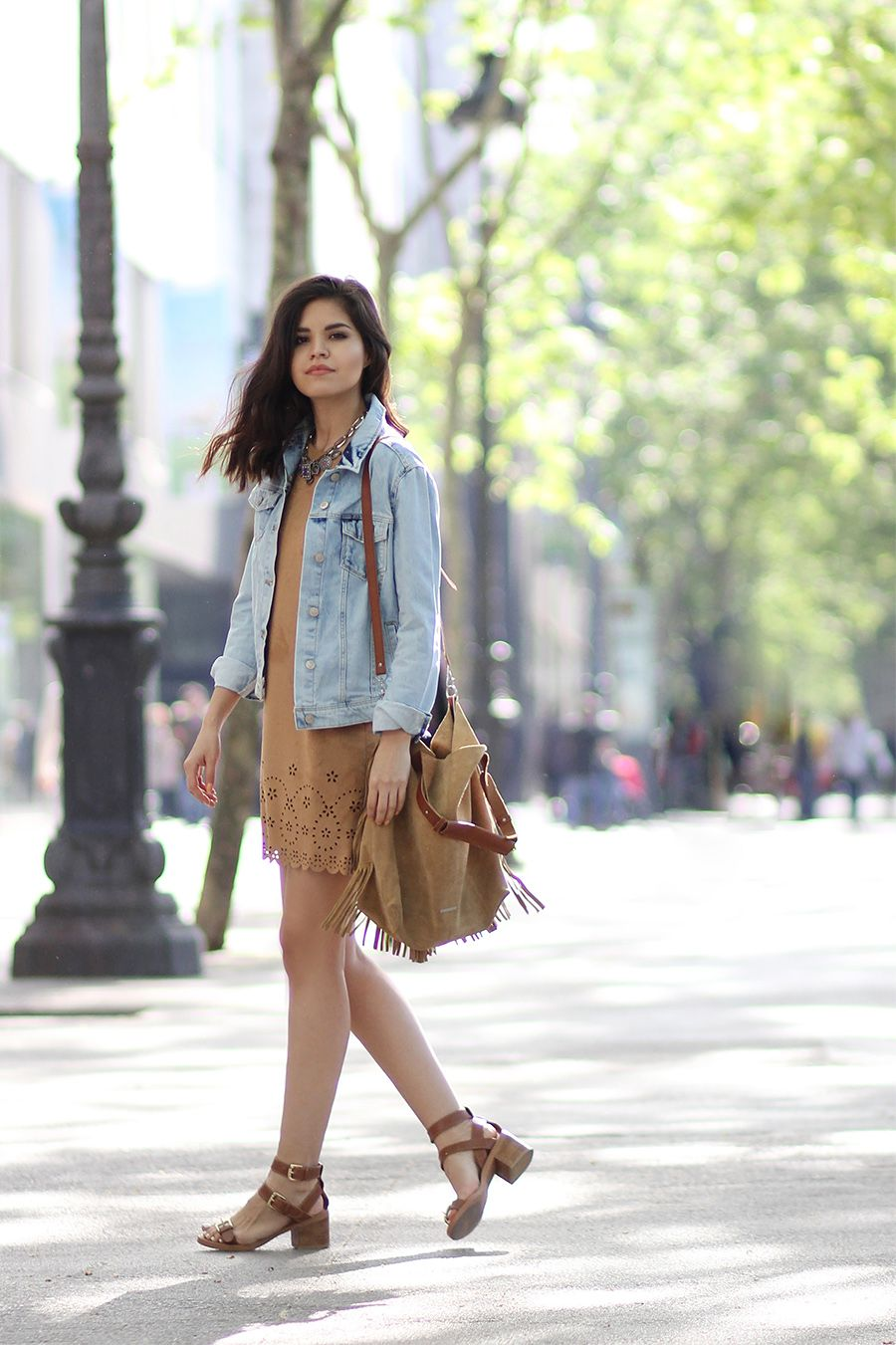 How To Wear A Suede Dress  Adriana Gastélum is wearing a camel suede dress  with a fringed suede sidebag 37d70d63a