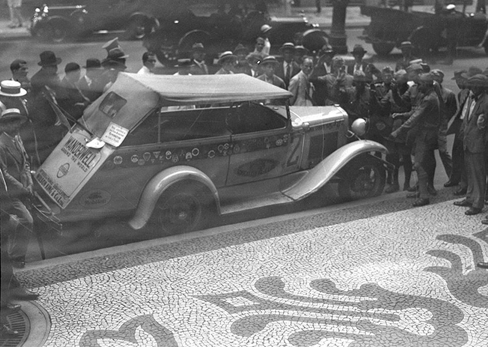 1930, Rio de Janeiro. Walter Wanderwell with expedition members, talks about the 1929 Model A Ford that replaced the 1918 Model T Fords, because of more hp and holding more film equipment and cargo. Crowds surrounded them where ever they went on their world journey.