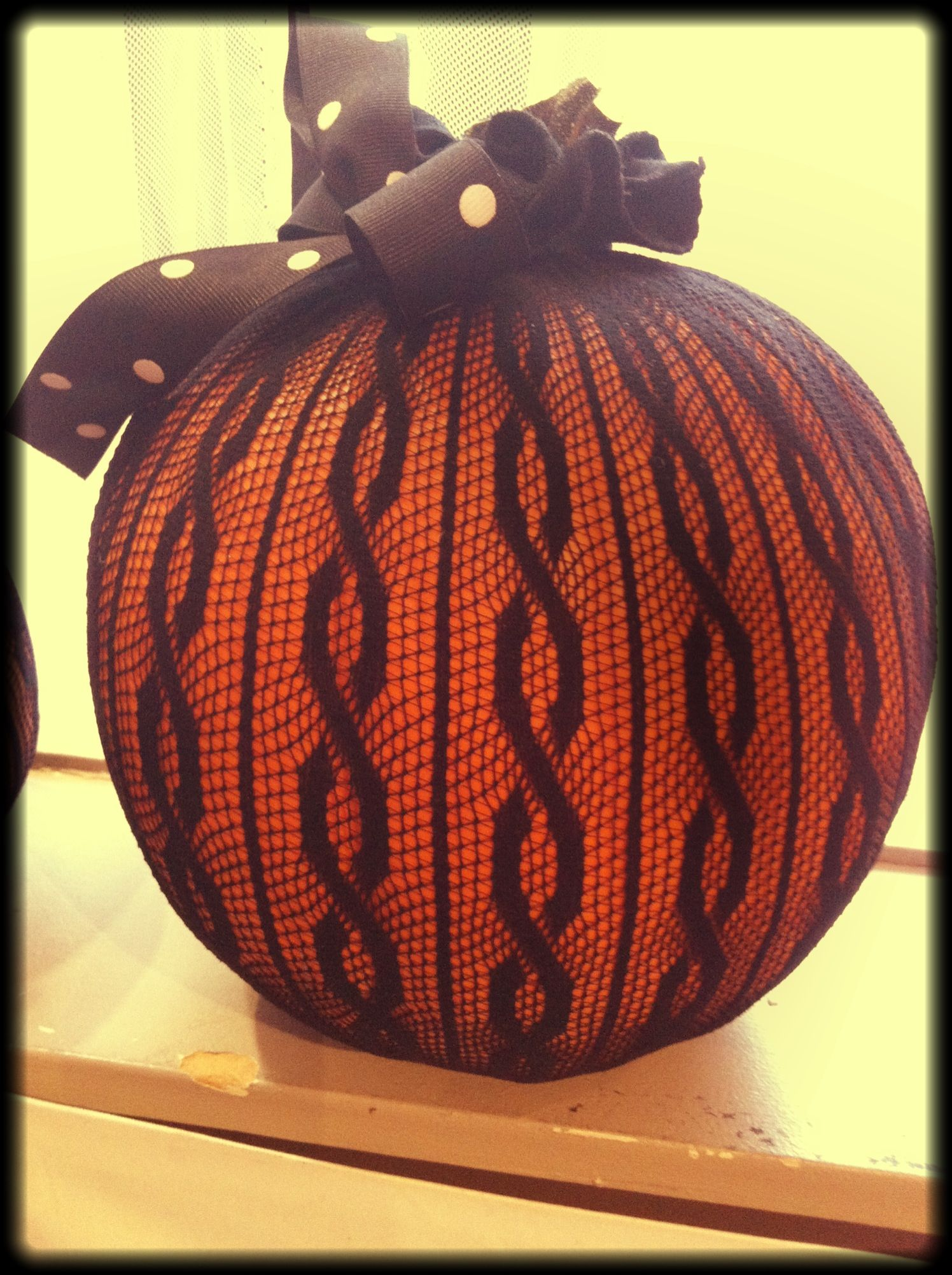 Fashion forward pumpkin decor pull a pair of tights over a pumpkin