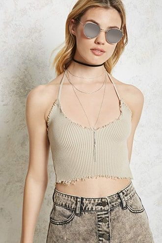 f611dae8b15509 Distressed Halter Crop Top. DetailsA ribbed knit crop top featuring a  V-neckline