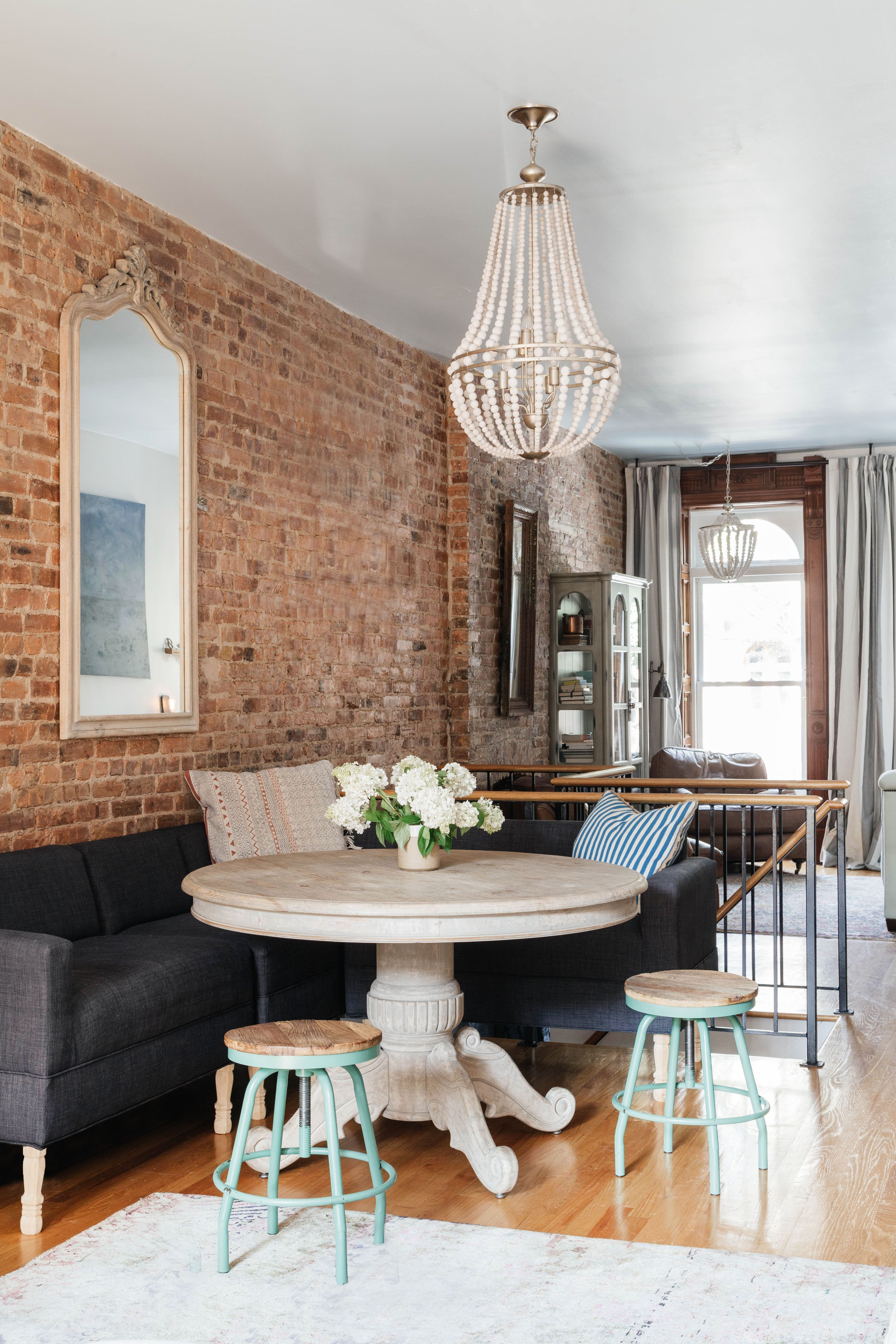 Wood Bead Chandelier And Exposed Brick Walls By Art Home Garden