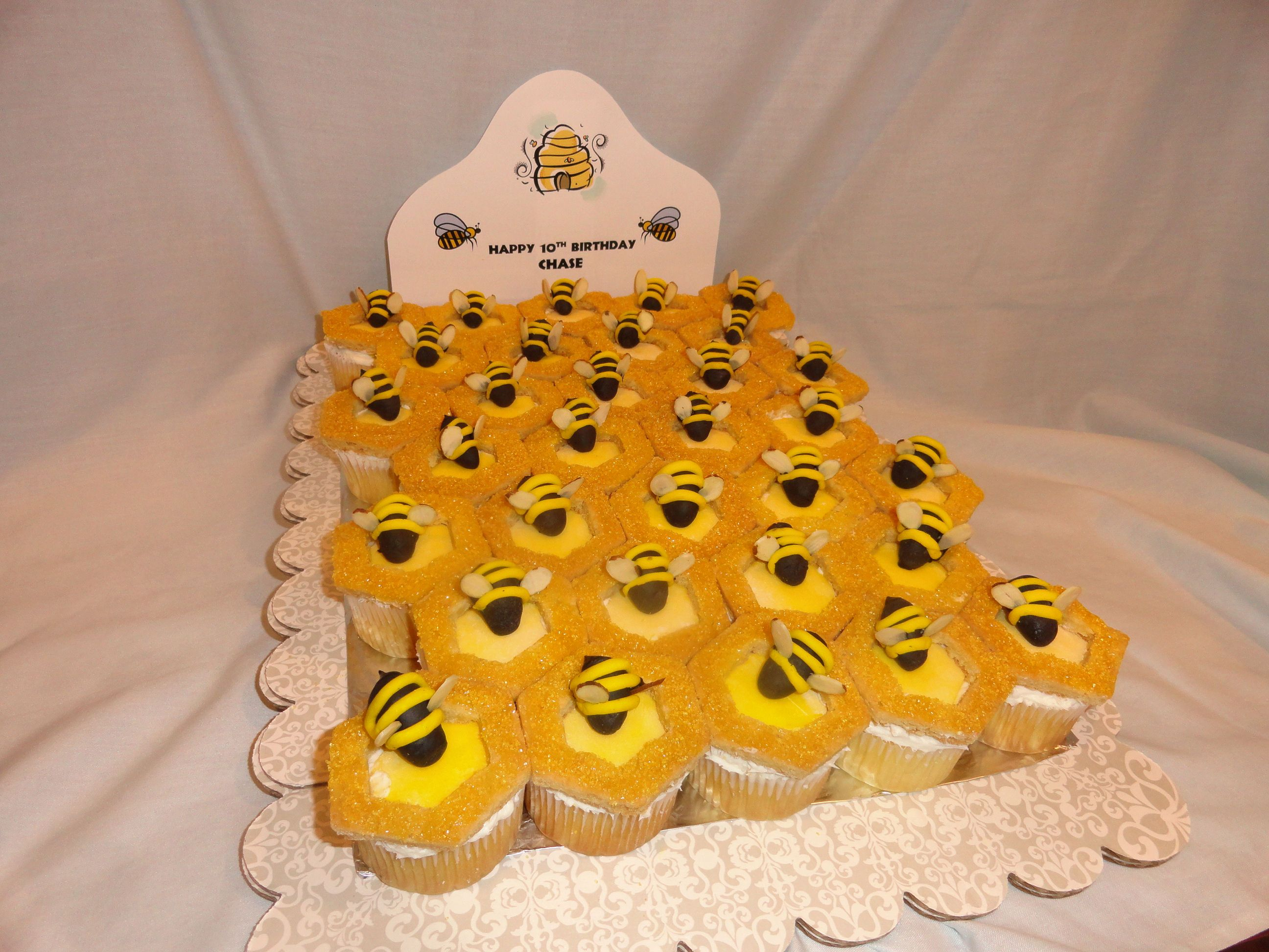 Beehive with Bees cupcake cake - cut out sugar cookies on top with fondant bees.