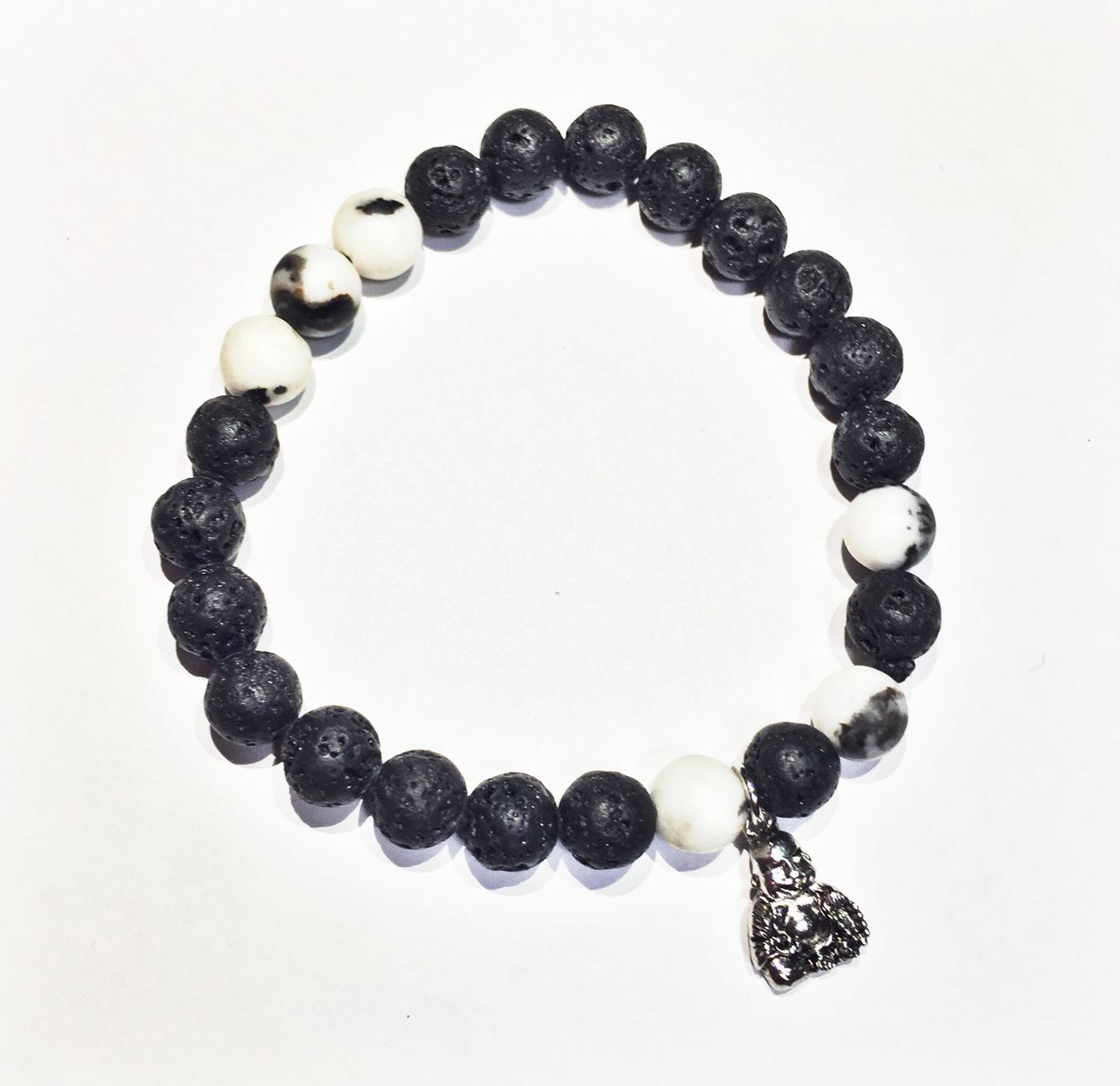 Handmade bracelet crafted from Lava Rock and Zebra Stone. Made by Unbound Essentials.