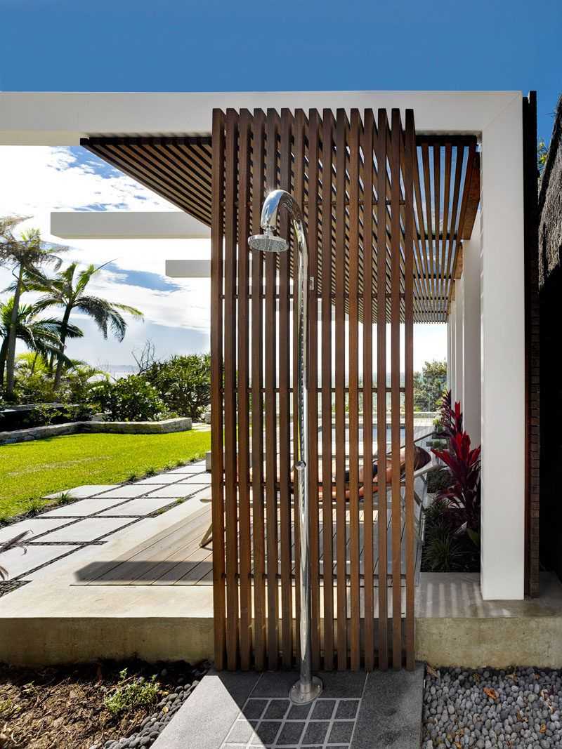 This wood and steel outdoor shower is ideal for rinsing
