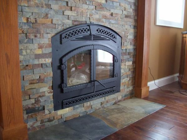 Tiled fireplace and S…