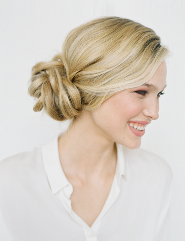 The Knotted Bun: Pony, twist, tuck and pin. Four simple steps and you've pulled off an elegant style with casual flair. Pretty enough for a wedding, relaxed enough for everyday. (via Once Wed)