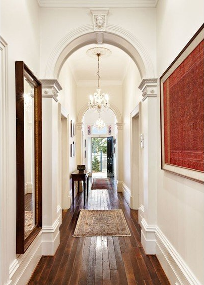 Hall art wood floors archway architecture interior design for Interior arch designs for house
