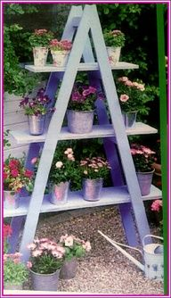 Cute idea  Paint wooden planks and a ladder and set up as a little gardendeck decor