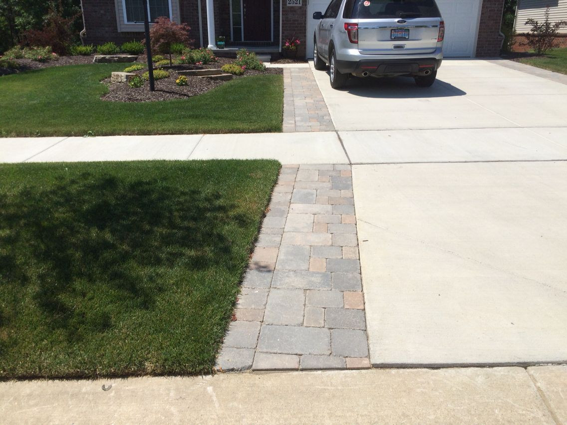 Brick paver tumbled driveway extension brick pavers for Brick sidewalk edging