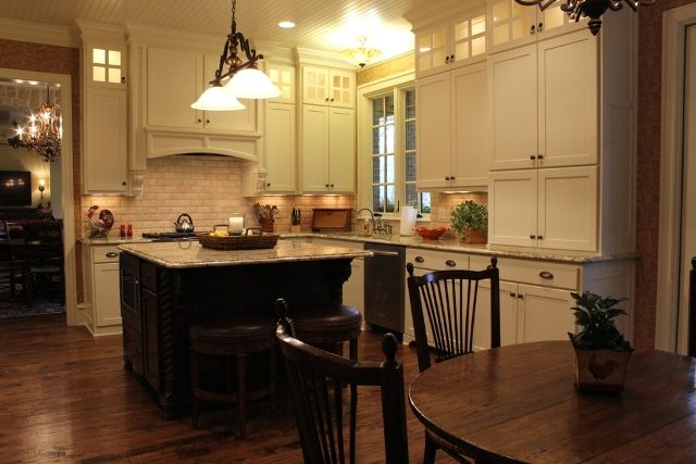 Texas kitchen with classic white cabinets, granite counter ...