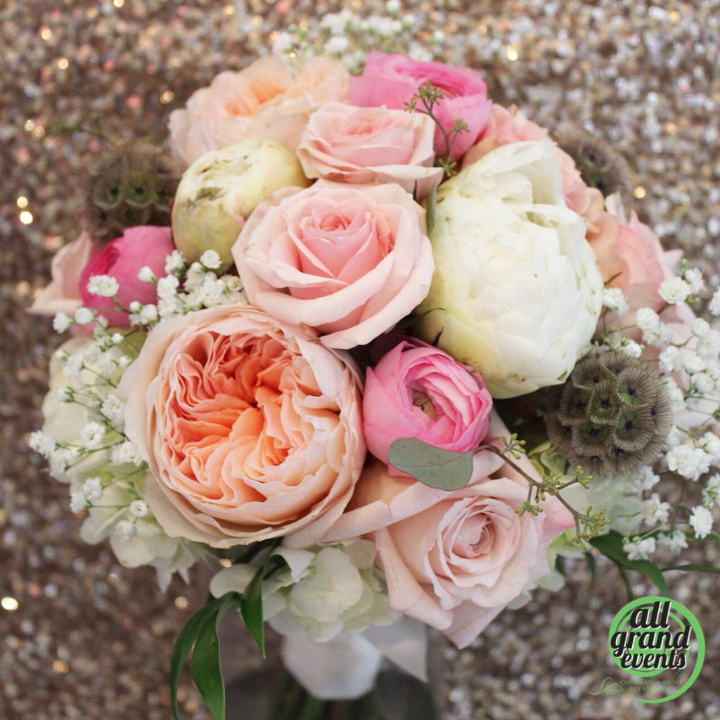 Garden roses, peonies, scabiosa pods, and much more! A beautiful bouquet designed by All Grand Events in East Lansing, MI
