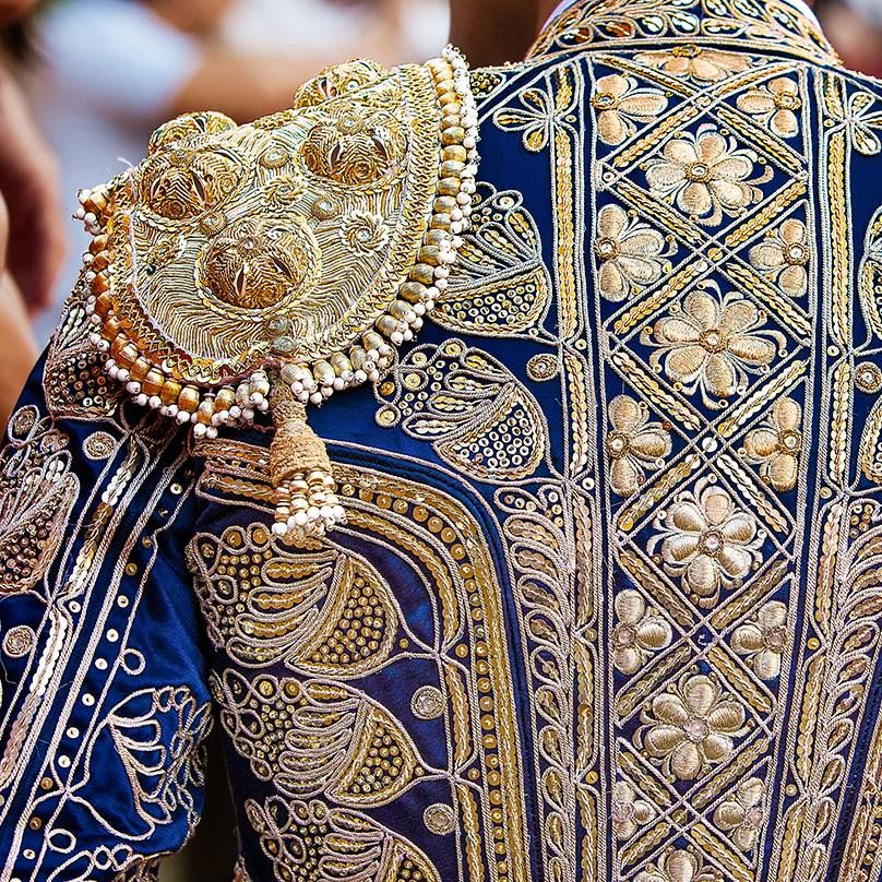 Before a Spanish torero enters an arena he is adorned in a traditional traje de luces (suit of lights). This detailed costume is a key element of bullfighting and the best suits are still made as they were in the early 20th century—by hand and without the use of machines.